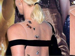 Charlize Theron w zdobionej biżuteryjnymi owadami sukni Diora