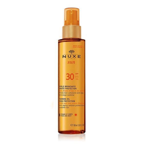 Ochronny spray do twarzy i ciała SPF 30, Nuxe Sun, ok. 100 zł.